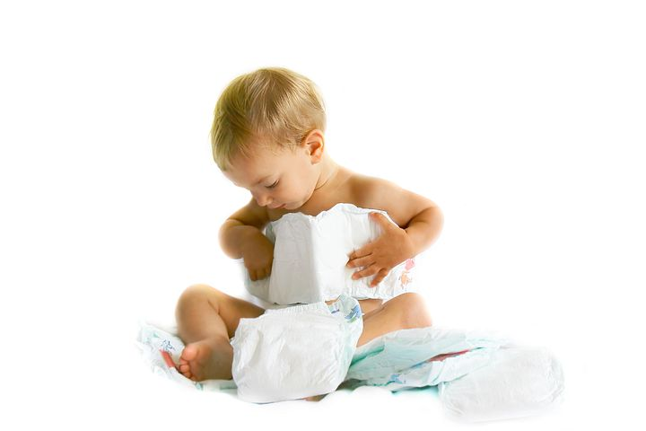 baby playing with diapers